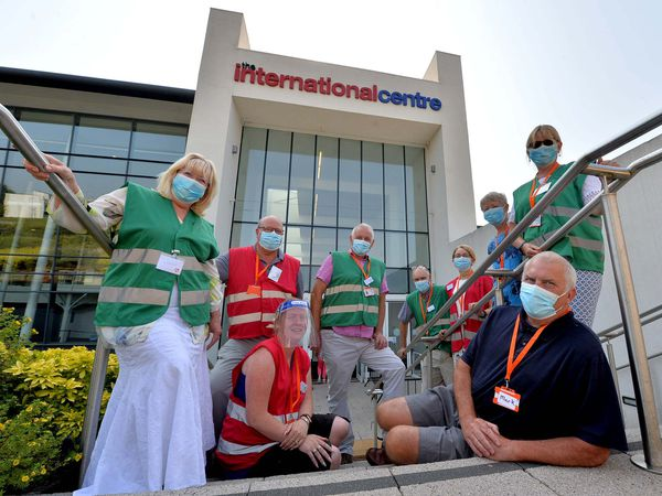 Volunteers at Telford International Centre, where thousands of people have received their first and second jabs.