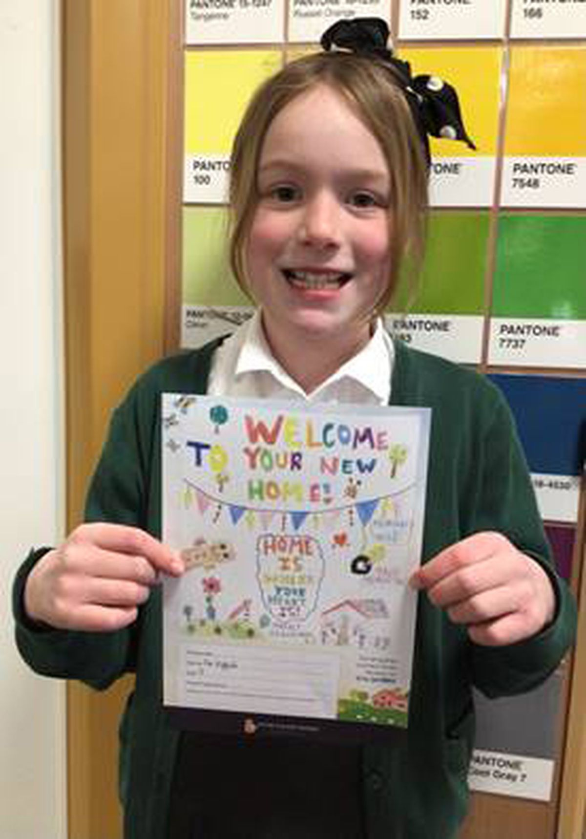 Ava with her winning card design.