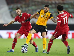 Nathaniel Phillips of Liverpool and Willian Jose of Wolverhampton Wanderers. (AMA)