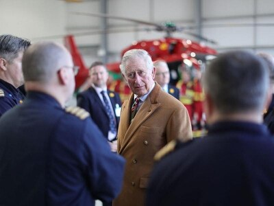 Prince Charles jokes with Bonnie Tyler and Max Boyce on air ambulance visit