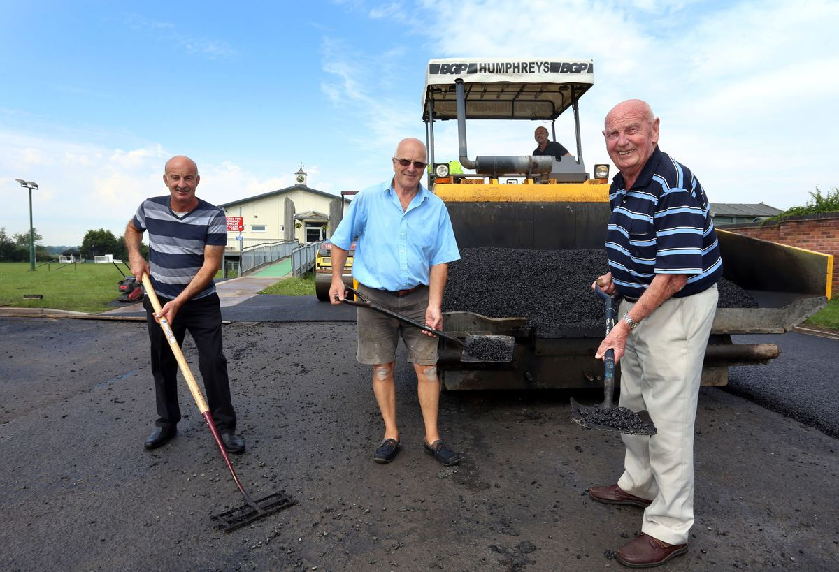 Club chairman Vinny Lines, Phil Hodges and president Ray Grocott oversee the resurfacing of the car park