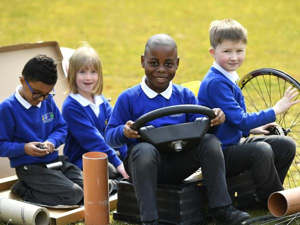 Year 2 children are pictured learning with the donated equipment from TC Homes