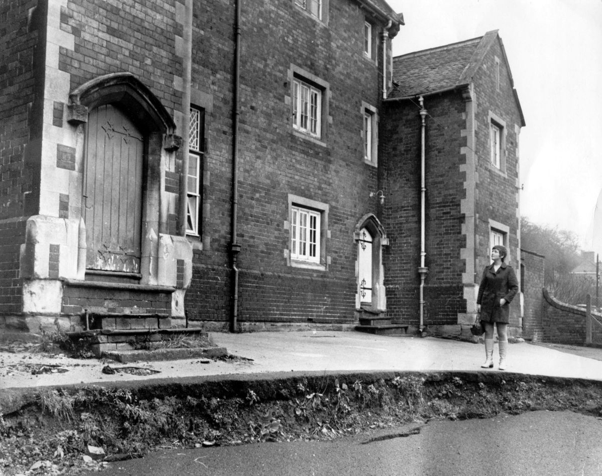 Parent Mrs Jennifer Kilshaw, of Lincoln Hill, Ironbridge, takes a close look at the subsidence at Ironbridge CofE School, on January 13, 1970 – the subsidence was the death knell for the school.