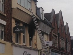 Man arrested over fire in flat above Telford shop