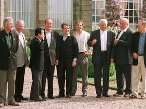 """Casual attire for """"the G Men"""" at the Weston Park G8 summit. From left: US President Bill Clinton, President of the European Commission Jacques Santer, Japanese Prime Minister Ryutaro Hashimoto, French President Jacques Chirac, Italian Prime Minister Romano Prodi, host and British Prime Minister Tony Blair, Russian President Boris Yeltsin, German Chancellor Helmut Kohl and Canadian Prime Minister Jean Chretien."""