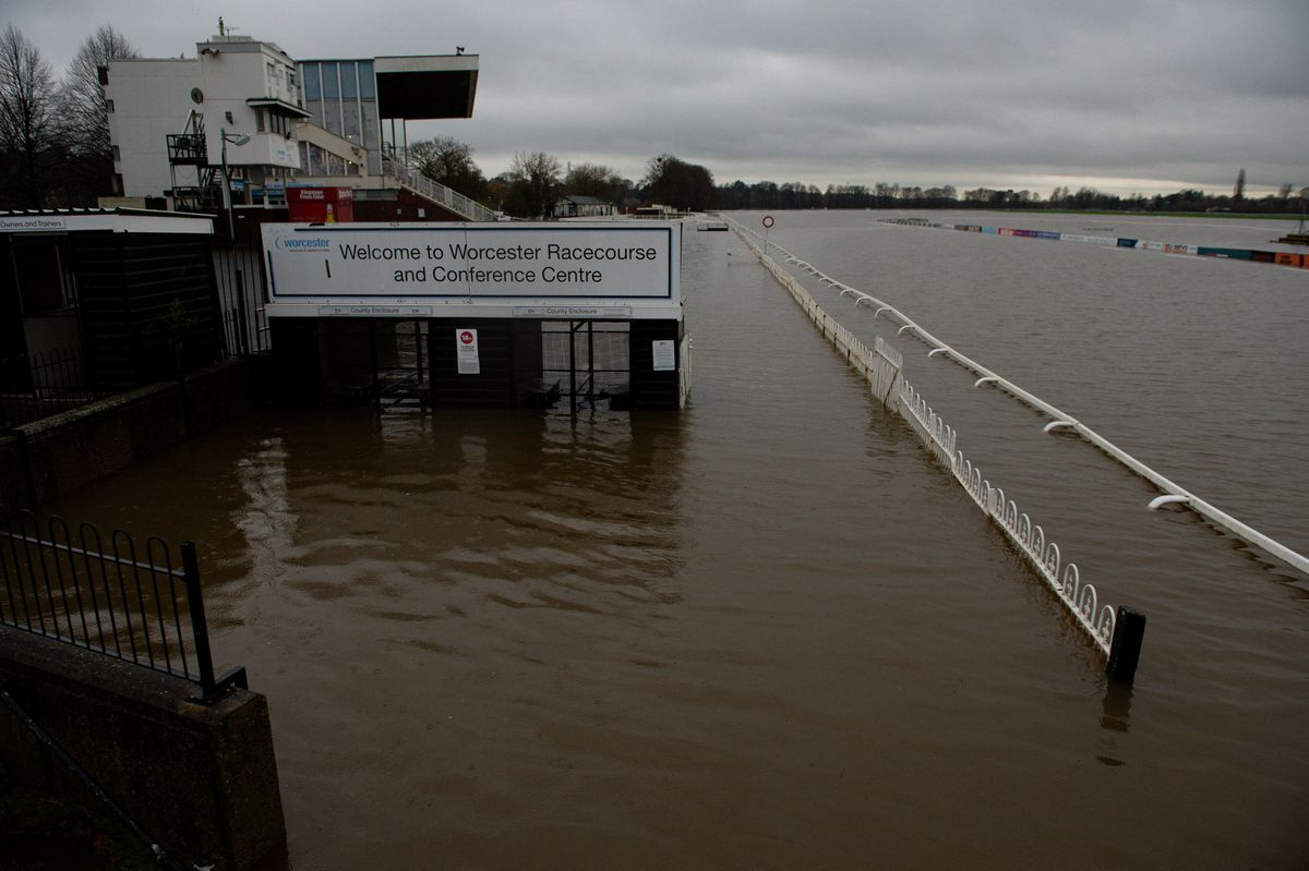 Flood water covers the racecourse at Worcester after heavy rain