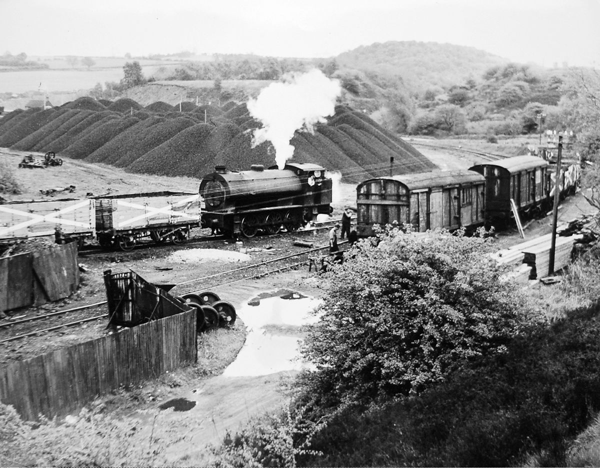 A picture dating from the last years of the Granville Colliery in Telford, taken by railway historian the late Russell Mulford. At the time the National Coal Board not only mined the coal but also had a retail coal distribution system based at The Wharf in Donnington, so much of the coal never moved more than five miles before being burned. The stockpile of coal in the picture was probably largely for retail use. Granville closed in 1979.