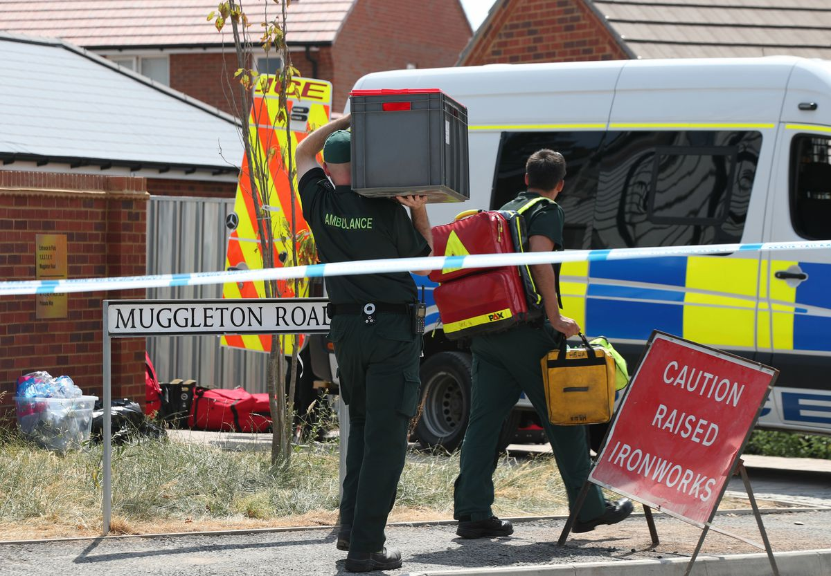 Members of the emergency services arrive at the house in Muggleton Road in Amesbury, Wiltshire, where counter-terrorism officers are investigating after a couple were left in a critical condition when they were exposed to the nerve agent Novichok