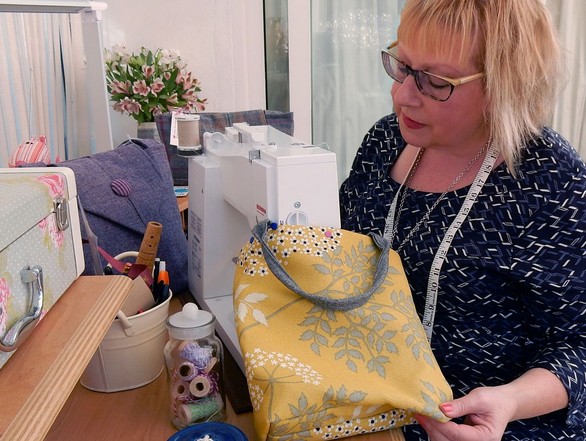 Sandra sewing one of her bags