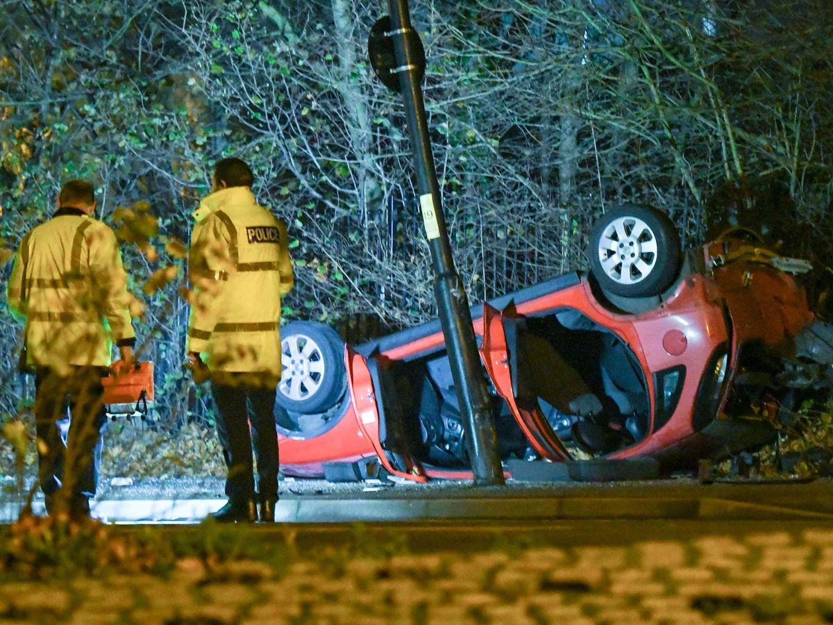 A red Corsa thought to have been used in a ram raid later hit a cyclist and overturned. Photo: SnapperSK