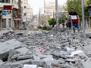A man stands amid the rubble following an Israeli air strike in Gaza City