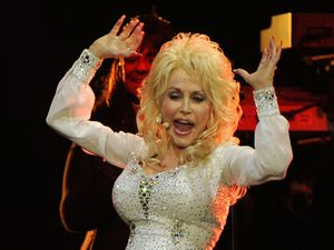 Dolly Parton live on stage at the LG Arena in Birmingham.
