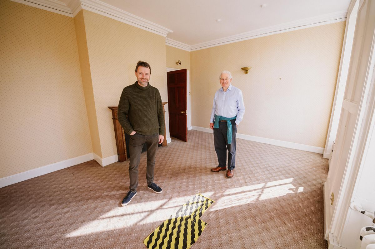 In the bedroom where Charles Darwin was born are Glyn Jones and Mark Scutt