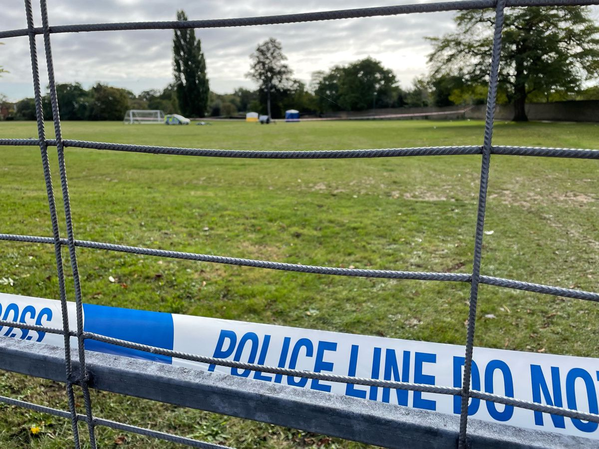 Police tape at the scene on a playing field in Craneford Way, Twickenham, south-west London, where an 18-year-old was stabbed on Tuesday afternoon