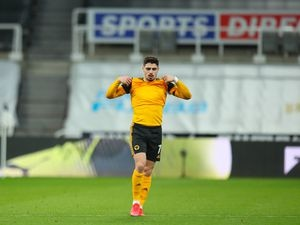 NEWCASTLE UPON TYNE, ENGLAND - FEBRUARY 27: Pedro Neto of Wolverhampton Wanderers reacts at the end of the game during the Premier League match between Newcastle United and Wolverhampton Wanderers at St. James Park on February 27, 2021 in Newcastle upon Tyne, United Kingdom. Sporting stadiums around the UK remain under strict restrictions due to the Coronavirus Pandemic as Government social distancing laws prohibit fans inside venues resulting in games being played behind closed doors. (Photo by Robbie Jay Barratt - AMA/Getty Images).