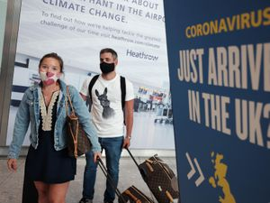 Passengers Charlotte, 29, and Frank, 30, Piazza arrive at Heathrow Airport