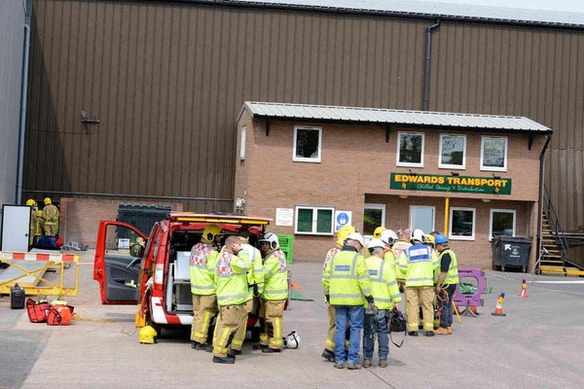 Emergency crews outside the Edwards Transport warehouse