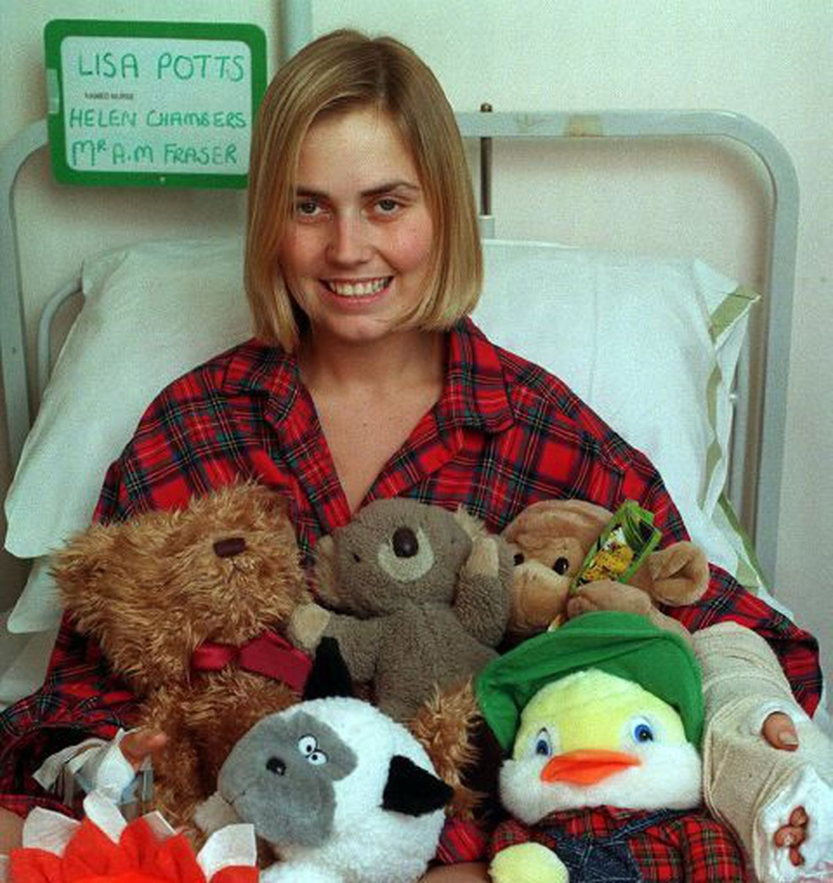 Lisa recovering in hospital with some of the gifts donated by well-wishers