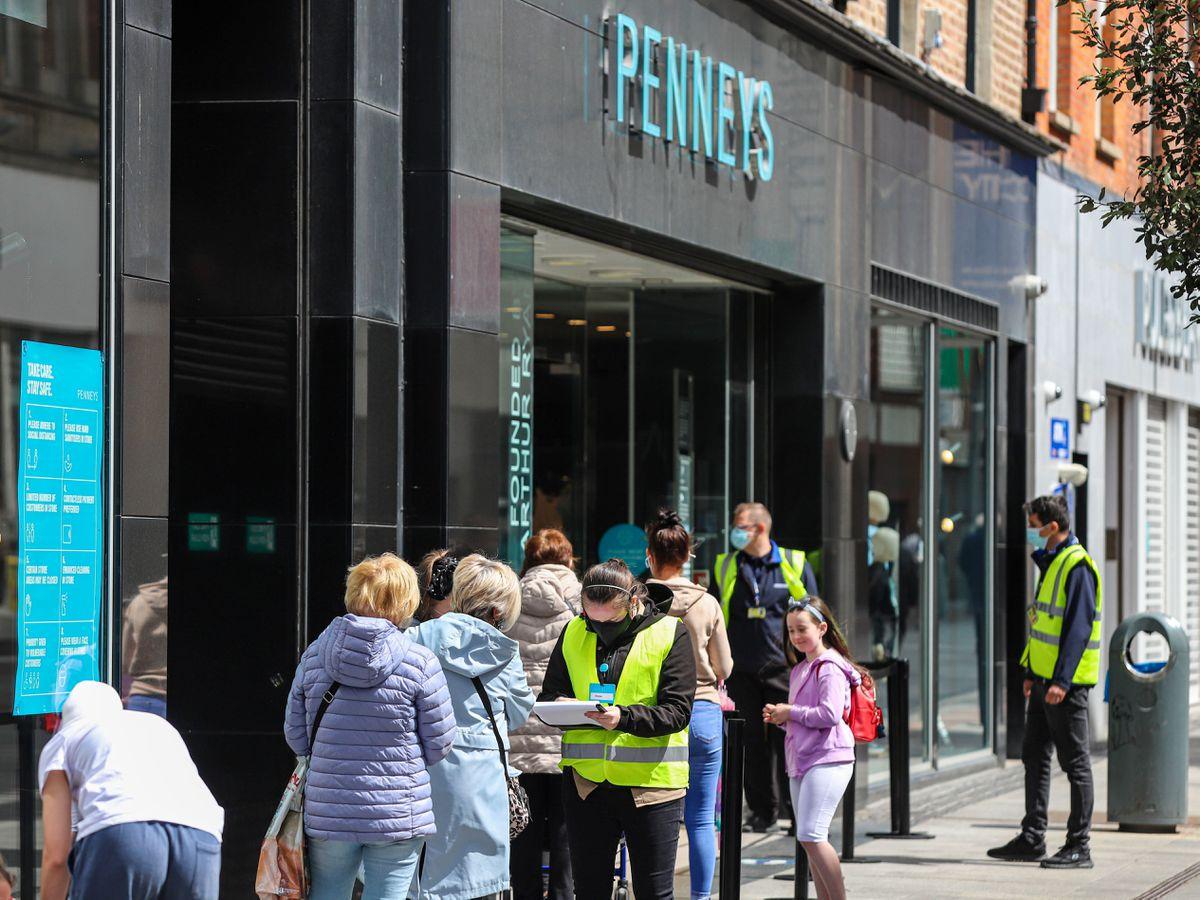 Shoppers queue in Dublin City centre