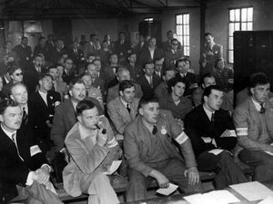Competitors, presumably including Peter Townsend (although we can't identify him) being briefed on the day of the race at Wolverhampton airport.