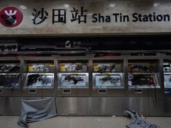 Hong Kong protesters trample Chinese flag and vandalise station