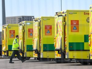A paramedic walks past parked ambulances as they await the first patients at the ExCel centre in London which is being made into the temporary NHS Nightingale hospital to help tackle coronavirus. PA Photo. Picture date: Wednesday April 1, 2020. A total of 1,789 patients have now died overall in UK hospitals as of 5pm on Monday, the Department of Health said, up by 381 from 1,408 the day before. See PA story HEALTH Coronavirus. Photo credit should read: Stefan Rousseau/PA Wire.