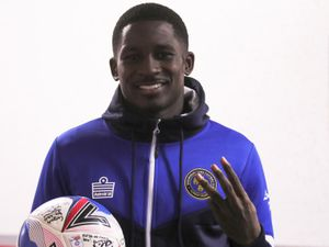 Shilow Tracey of Shrewsbury Town poses for a picture with the match ball after scoring a hat trick (AMA)