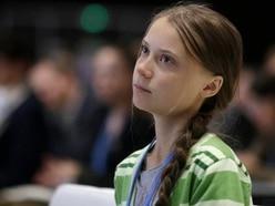 Greta Thunberg stuck on floor of crowded German train after climate summit