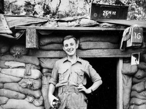 "Young National Serviceman Alan outside his ""residential bunker"" in Korea."