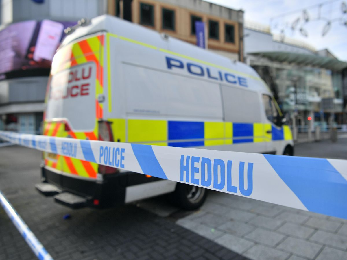A police van and police tape in Cardiff city centre