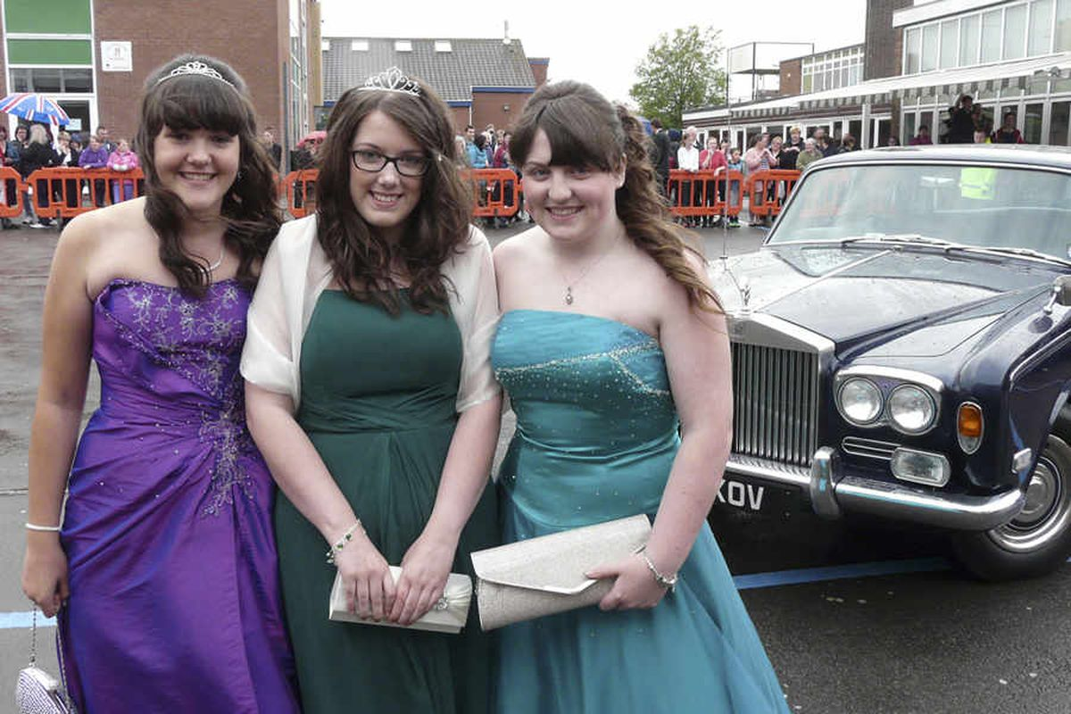 Grange pupils Beth Byrne, Molly-Jane Watkins-Fruen and Shannon Lawless-Dean who arrived at the prom in a vintage Rolls Royce.
