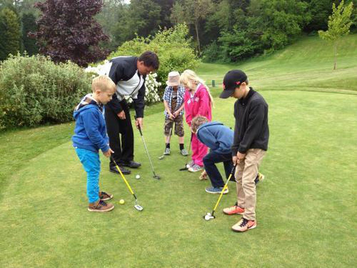Pro Steve Russell teaches a group at Bridgnorth Golf Club