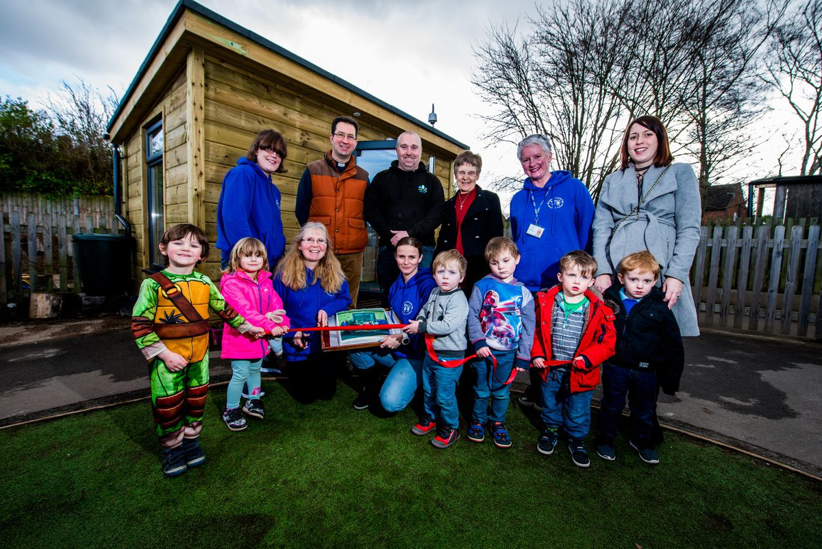 A new learning building has opened at Christchurch Pre-School Nursery based at Oakmeadow School in Bayston Hill. Pictured are pre-school staff and children, Rev Peter Hubbard and Paul Kynaston from Little Village Group
