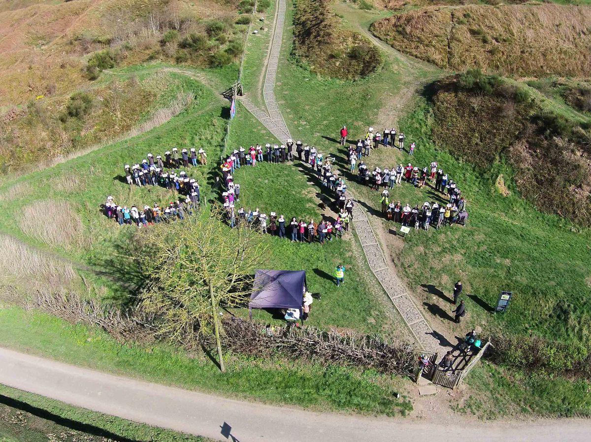 Campaigners hugging Oswestry hillfort last week