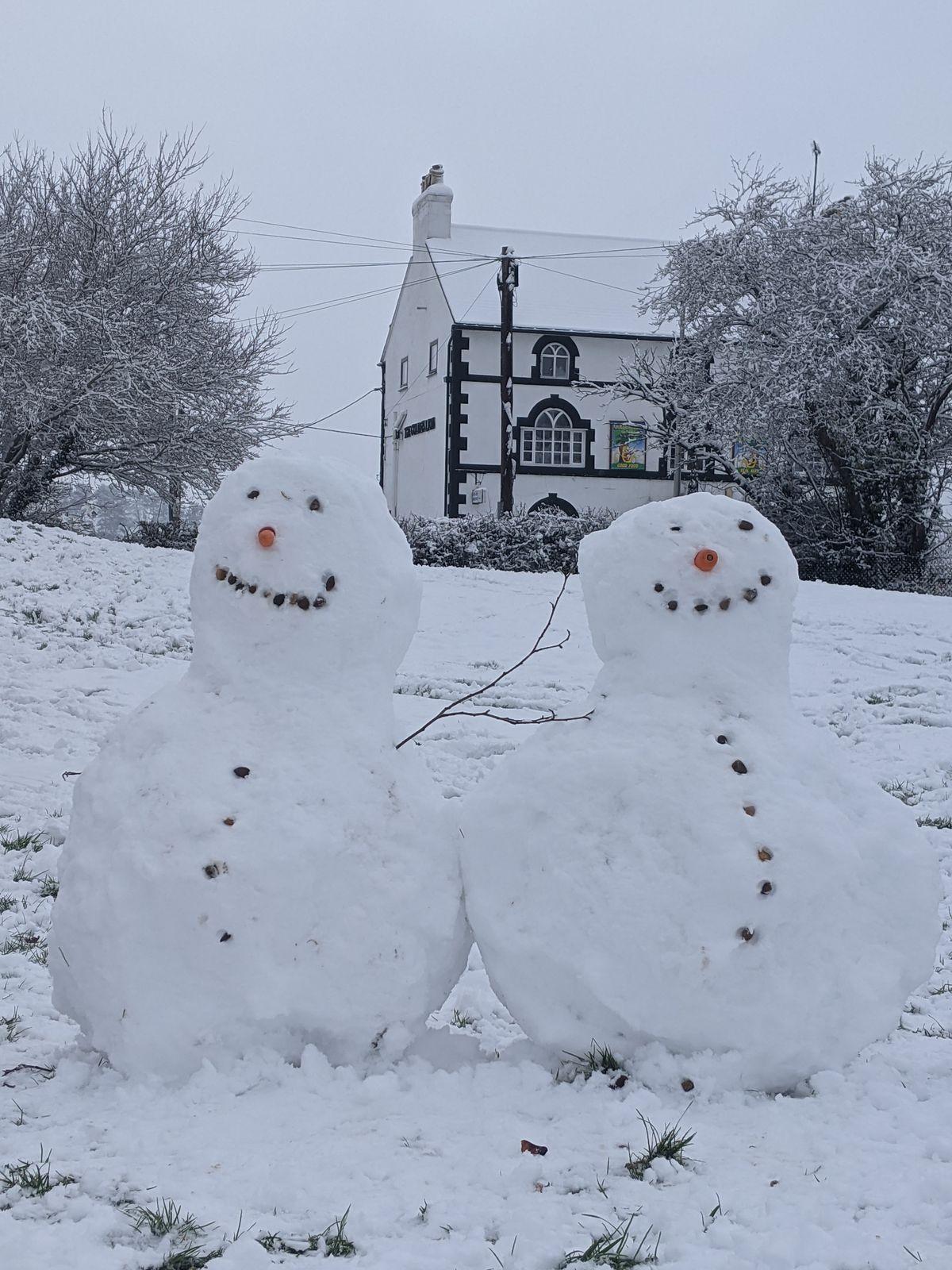 Snowmen in Four Crosses, near Oswestry. Photo: Steve Peter