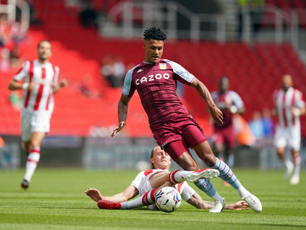 """Aston Villa's Ollie Watkins battles with Stoke City's Ben Wilmot during the pre-season friendly match at the bet365 Stadium, Stoke-on-Trent. Picture date: Saturday July 24, 2021. PA Photo. See PA story SOCCER Stoke. Photo credit should read: Nick Potts/PA Wire. ..RESTRICTIONS: EDITORIAL USE ONLY No use with unauthorised audio, video, data, fixture lists, club/league logos or """"live"""" services. Online in-match use limited to 120 images, no video emulation. No use in betting, games or single club/league/player publications.."""