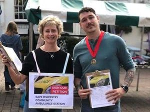 Sian Tasker and Jay Moore collect signatures