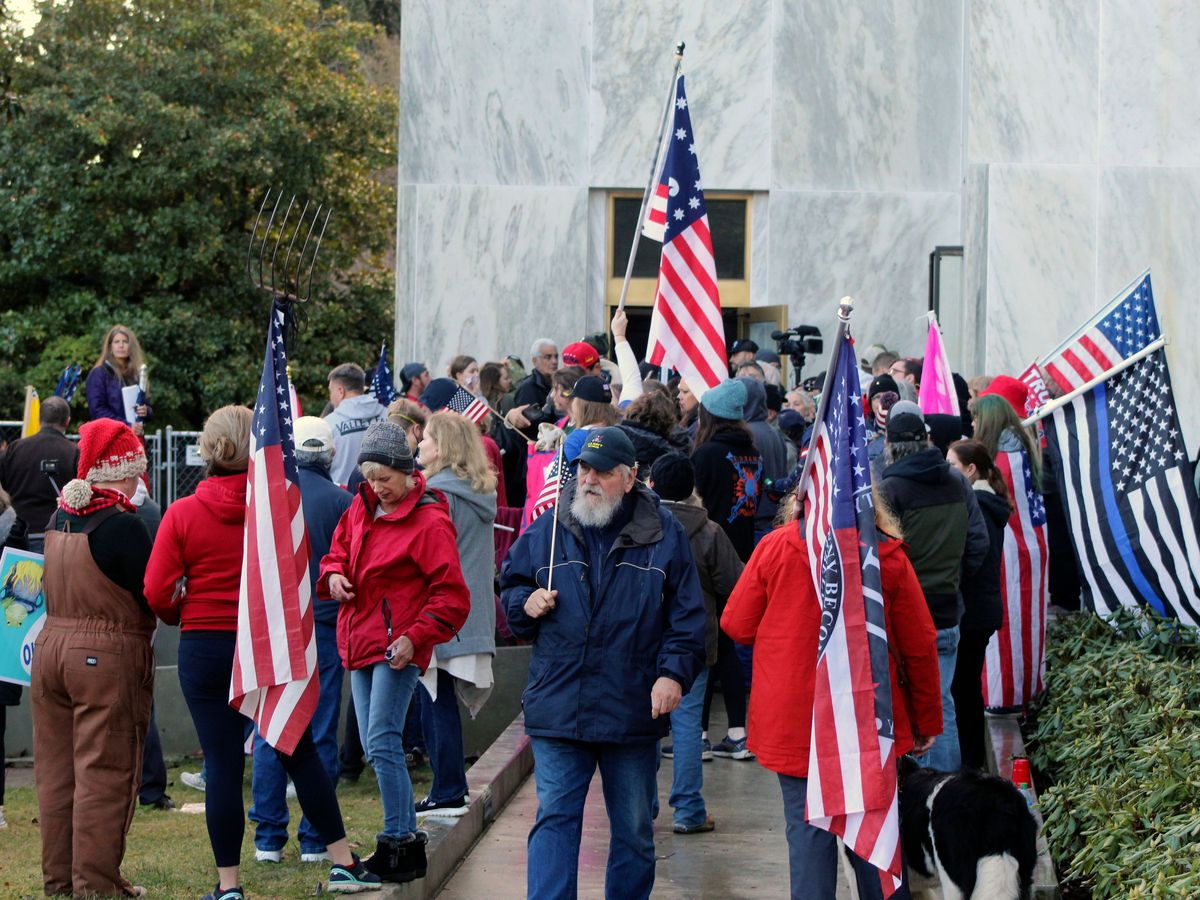 Pro-Trump and anti-mask demonstrators hold a rally outside the Oregon State Capitol last December