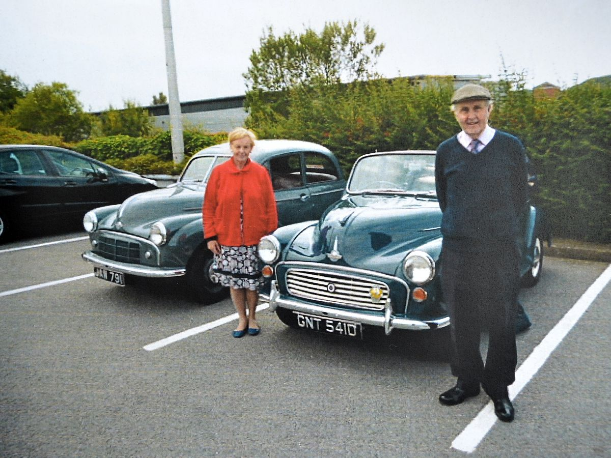 """Back """"home"""" - Martin and Eunice with their faithful Moggy in Wellington, which is lined up alongside Roger Martin's own 1952 model."""