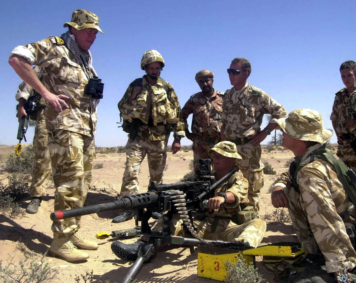 Admiral Nugent, Commander of UK Maritime Forces, talking to some Royal Marines of 40 Commando during exercise Saif Sarrea II in Oman in 2001. PA Photo: PO[Phot]Lewis.S.J./Royal Navy  Handout