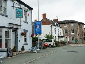 The Dolphin in Llanymynech, left, is in Wales so must stay closed. The Cross Keys, on the far right, is in England so can open.
