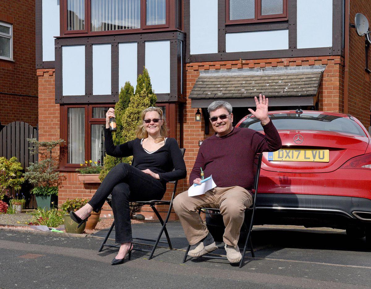 Tina and Tony Adams enjoy the game