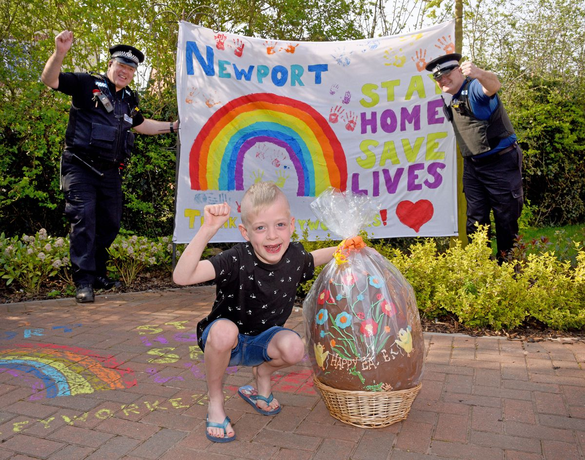 Cooper Nash, aged six, with PCSO Andy Protheroe and Pc Lee Thomas