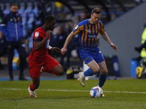 Shaun Whalley of Shrewsbury Town and Tendayi Darikwa of Wigan Athletic (AMA)