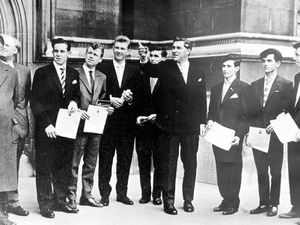 The seven award winners with Wrekin MP Bill Yates (pointing) outside the Houses of Parliament. Left is school head Harold Fletcher, deputy head Norman Pickering, and then pupils George Hull, David Jones, David Hall, Ross Vickers, Billy Acton, Arthur Howells and Raymond Williams.