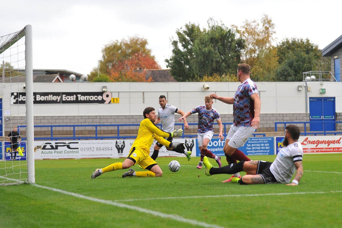Gateshead goalkeeper James Montgomery (formerly AFC Telford) saves from Shane Sutton