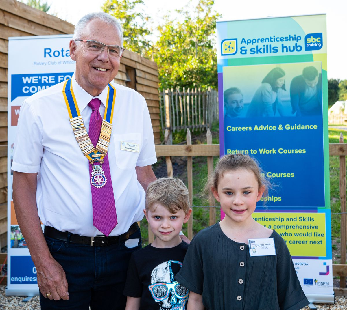 Rotary Club president Dave Simcock with Charlotte and William Titchen