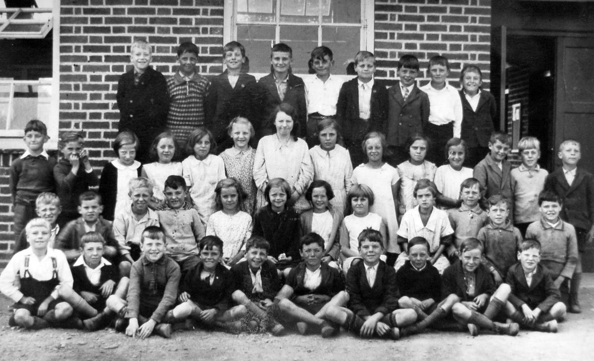 """Some of the pupils of Criftins CofE School, Dudleston Heath, around 1933. This picture came from one of them, Allan Peever. Allan, who was born in 1924, died earlier this year. He is back row, extreme right.  """"I never grew to be very tall. I finished up 5ft 7 and a half inches. I'm standing on tip toes trying to make myself a bit taller,"""" Allan, from Weston Rhyn, told us."""