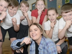 X Factor contestant Georgia shows Shropshire pupils she's a class act