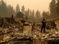 Guard troops search for more wildfire victims as death toll rises to 56